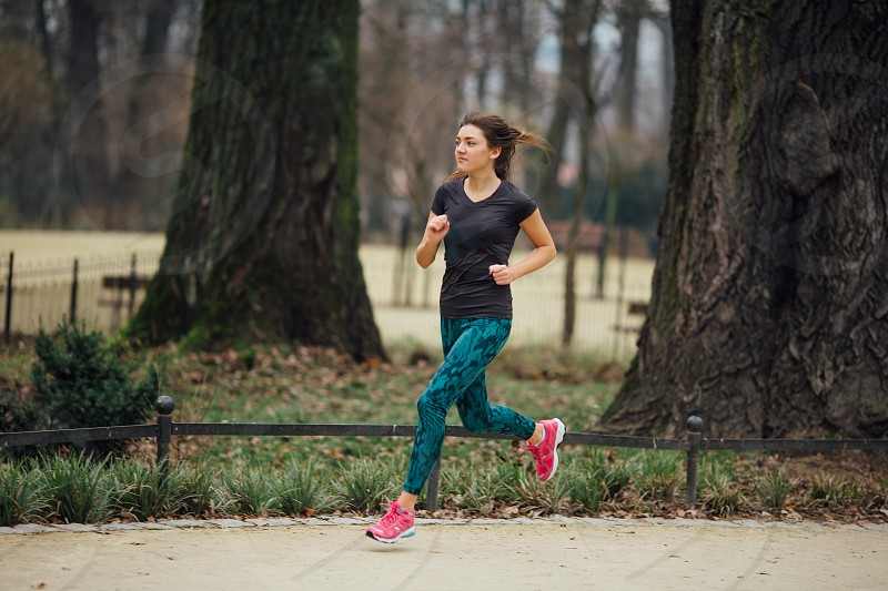 Young girl running in the park photo