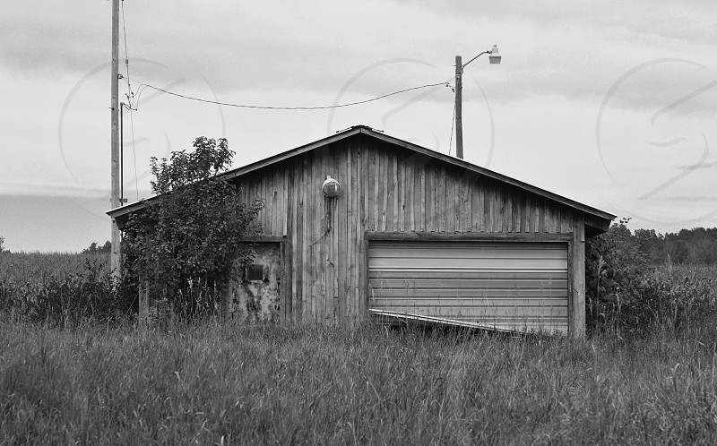 An abandoned garage sits in a small town of Northern Michigan. photo