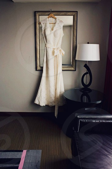 New beginnings wedding day wedding dress bride bridal suite wedding dress in front of a mirror photo