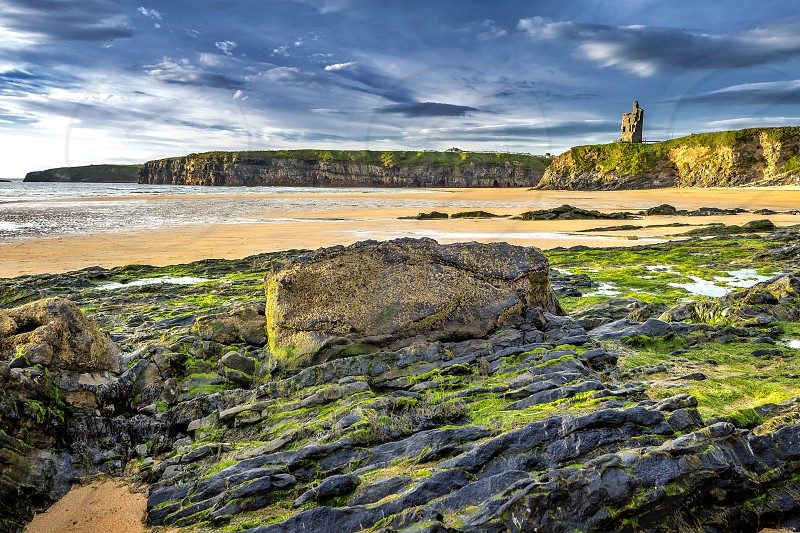 Ballybunion Castle is one of fifteen cliff forts on the North Kerry coast. In the summer Ballybunion attracts many families and young people to enjoy the sandy beach warm Atlantic waters and the pubs along the high street. Nearby cliffs offer excellent scenery.  photo