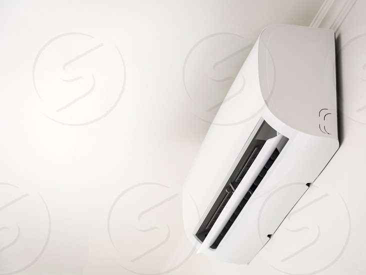 Air conditioner cooling fresh system saving energy on white wall background photo