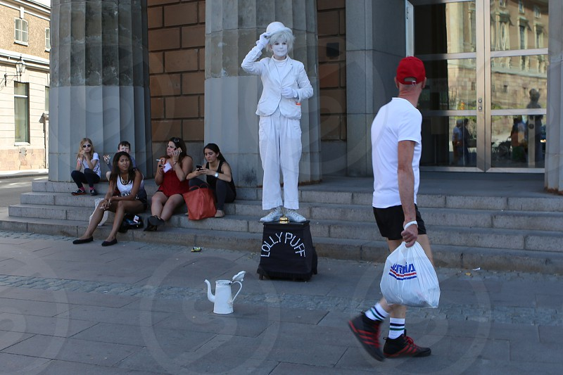 Street performer Stockholm Sweden. Mime acting photo