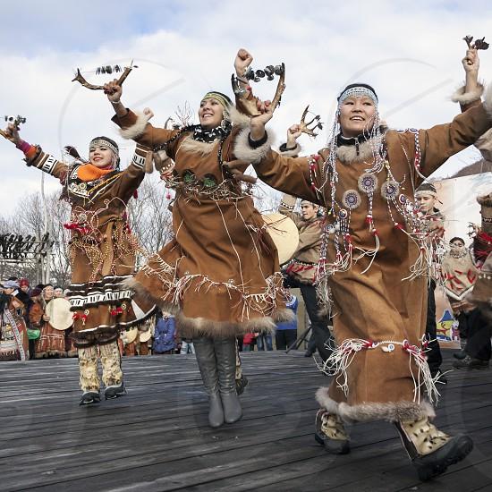 PETROPAVLOVSK KAMCHATSKY CITY KAMCHATKA PENINSULA RUSSIAN FAR EAST - NOVEMBER 4 2010: Folk ensemble performance in dress of indigenous people of Kamchatka. Day of the seal - a traditional celebration ritual Koryak Hololo. photo