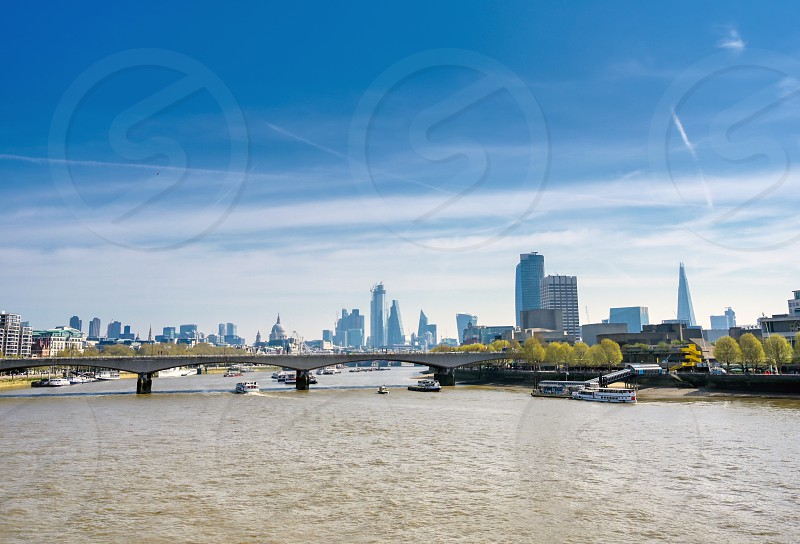 A view along the River Thames on a sunny day in London UK. photo
