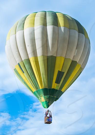 Green Balloon on blue sky photo