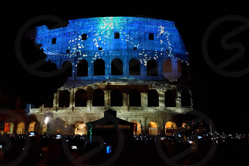 Hundreds of phones and tablets being used to photograph/video the Festival of Lights at the Colosseum in Rome. photo