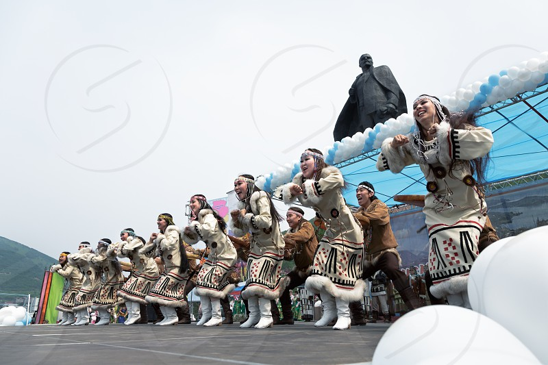 PETROPAVLOVSK CITY KAMCHATKA PENINSULA RUSSIA - JULY 1 2012: Concert of State Academic Koryak National Dance Ensemble Mengo. July 1 - celebration Feast Day of formation of Kamchatka Region. photo