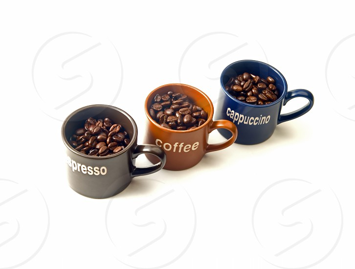 coffee espresso cappuccino cups with coffee beans isolated on white background photo