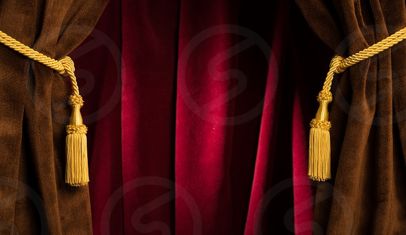 Red theatre curtains and yellow tassels photo