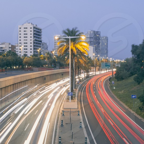 cars fast city barcelona pollution lanes symmetry light trails long exposure urban photo
