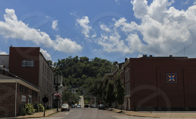 Maysville KY July 15 2016.  View of the hill from Sutton St. businesses and landscaping. photo