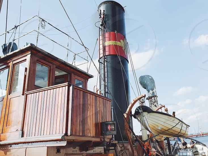 Boating lifestyle  boats ship steamship wooden ship chimney transport  photo
