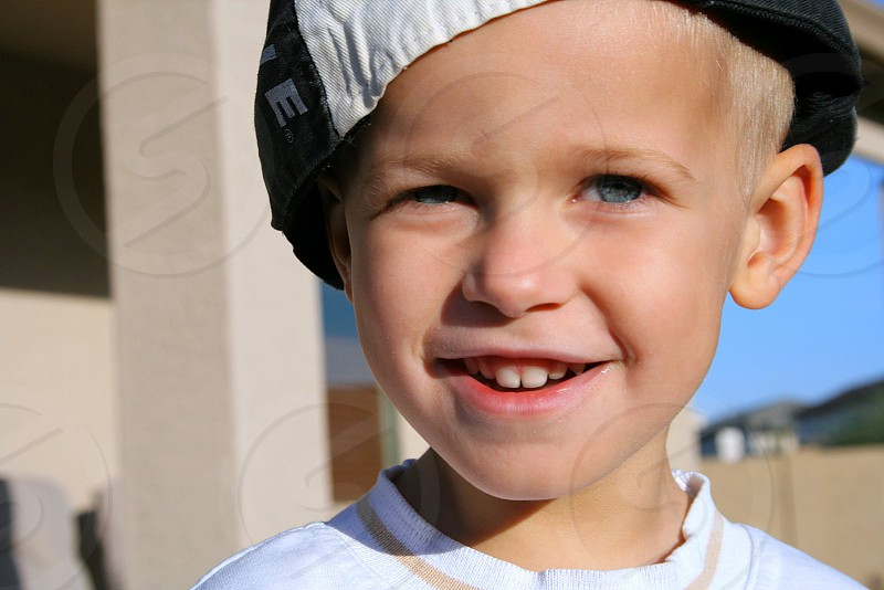 Young boy blue eyes great smile hip fun photo