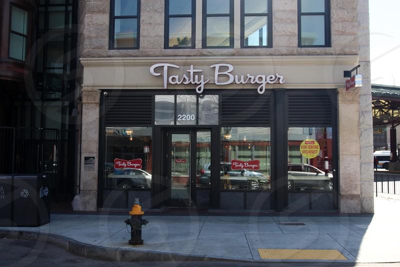 close tasty burger shop beside road during daytime photo