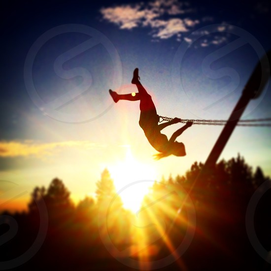Swinging in the Sunset photo