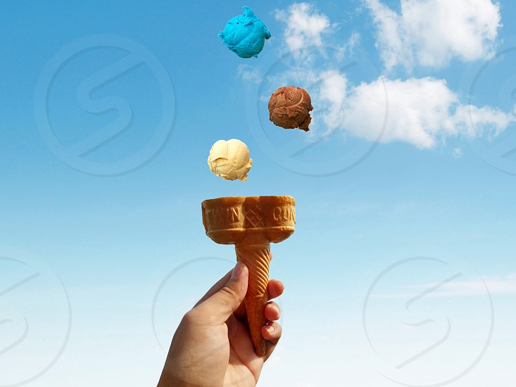brown blue and white ice cream scoops in the air photo