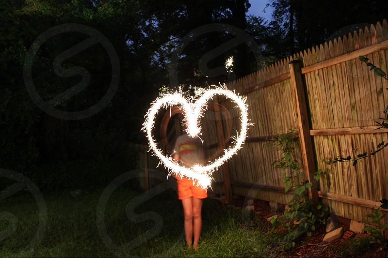 Sparkler heart at night photo