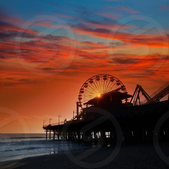 Santa Monica California sunset on Pier Ferrys wheel  in orange sky photo