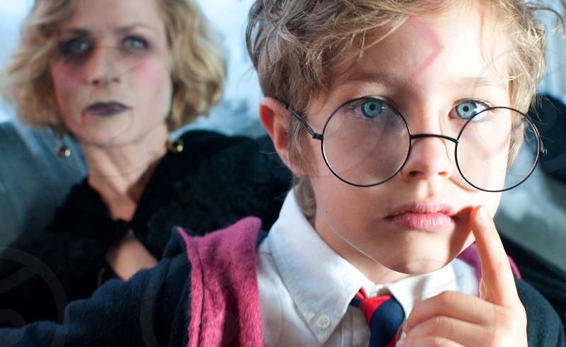 child in black round rimmed eyeglasses photo