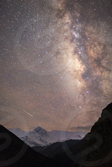 The shooting star over the Himalayas photo