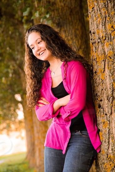 Happy young woman smiling tree green Forrest  photo