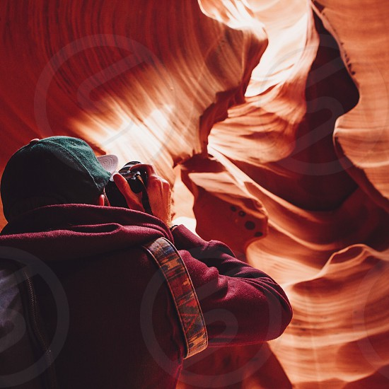 person taking photo of a cave photo