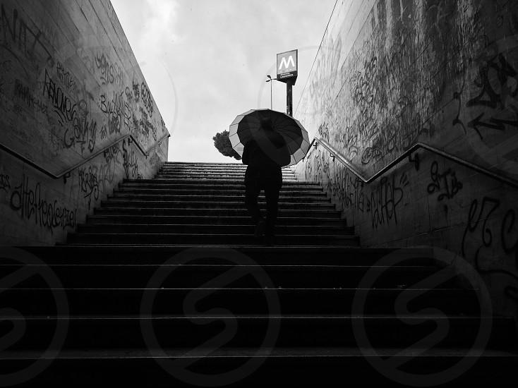 #rain #umbrella #metro #stairs #blackwhite  photo