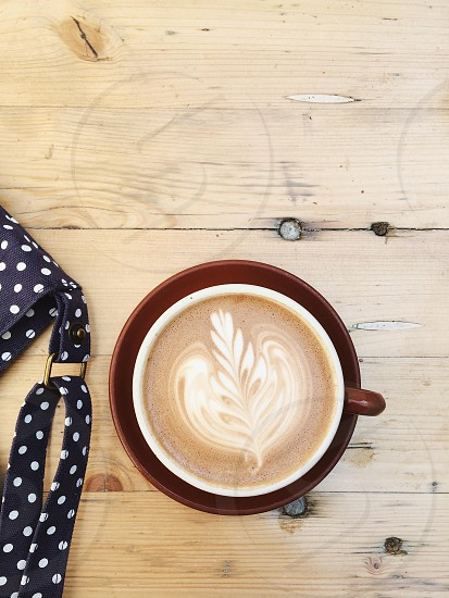 leaf design cappuccino coffee photo
