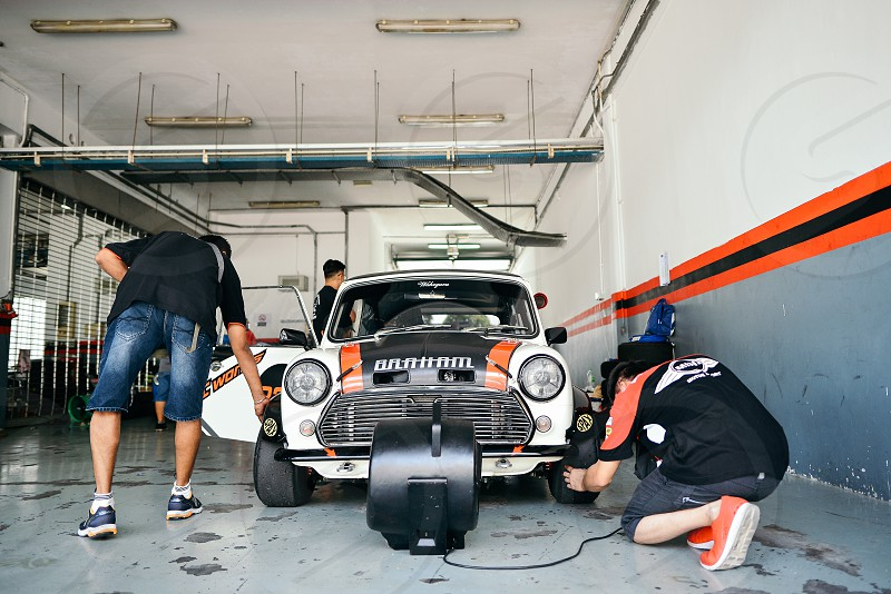 Working on a race car in the paddock photo
