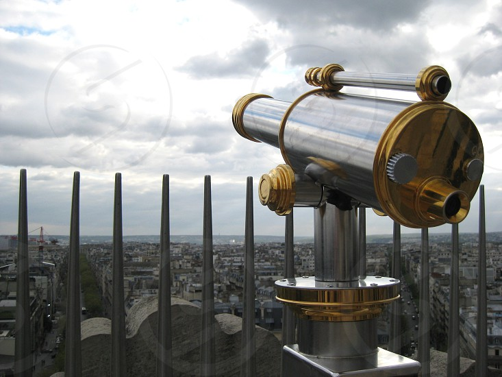 gold tone and stainless steel telescope photo