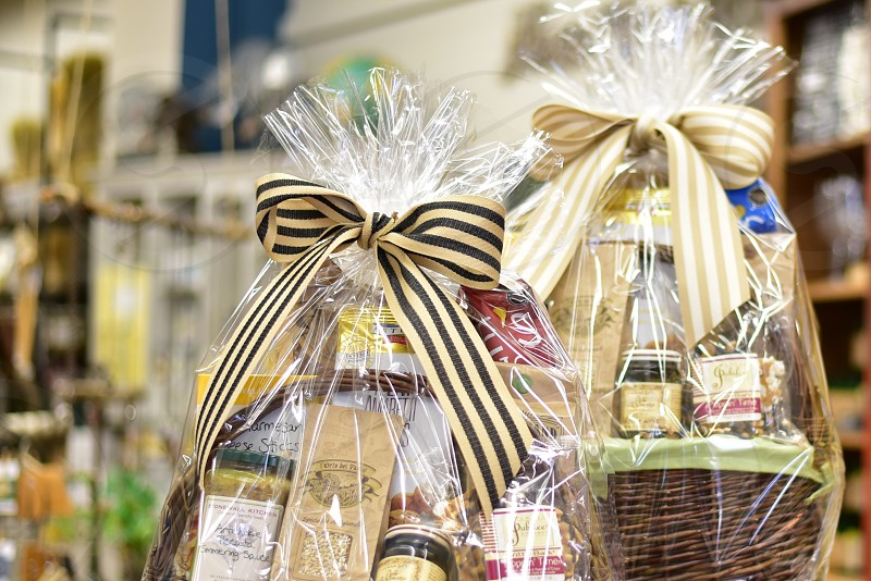 Ribbons tied into pretty bows on gift baskets photo