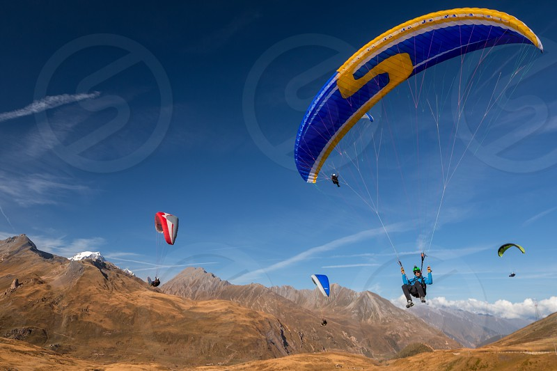 Paraglider paragliding airborne active sports extreme flying mountains landscape leisure fly  photo