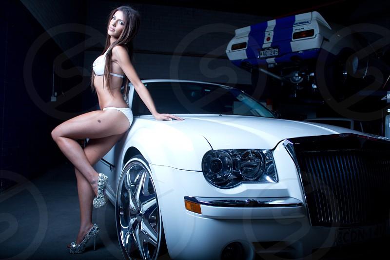 Girl with white Chrysler 300c photo