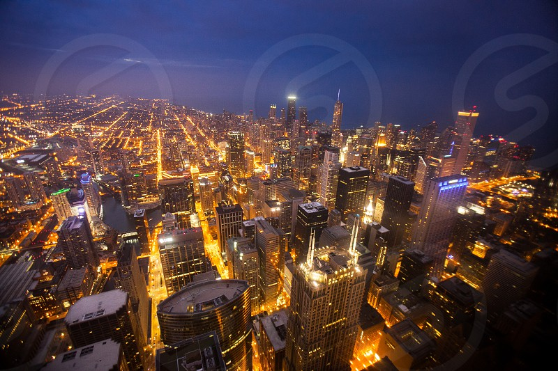 Chicago by night. Streets highrise lake orange blue urban city buildings. photo