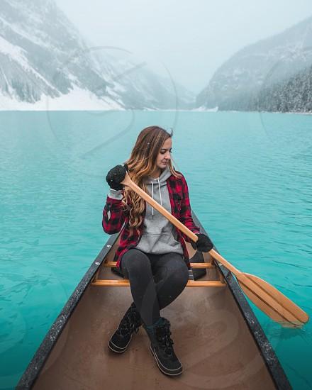 Woman plaid lake lake Louise emerald green blue cool cold snow winter cozy canoe photo