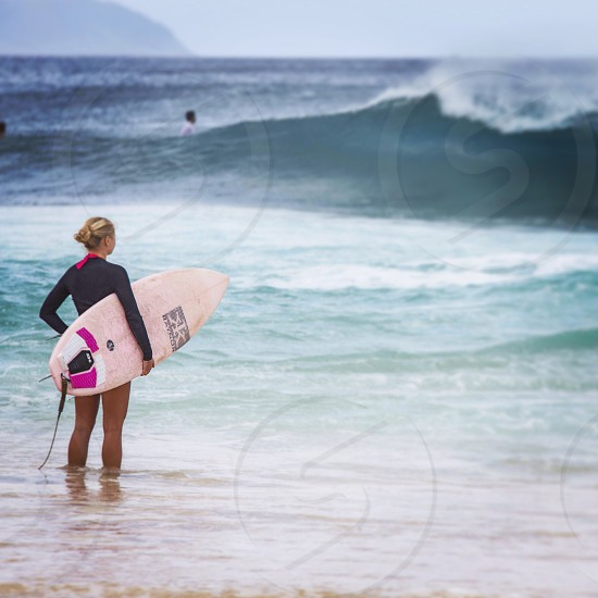woman with white surfing board photo