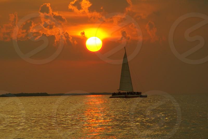 sailing boat at sunset photo