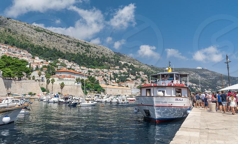 Dubrovnik Croatia - 07. 13. 2018. Pleasure boat in the old port of Dubrovnik Croatia on a sunny summer day. photo