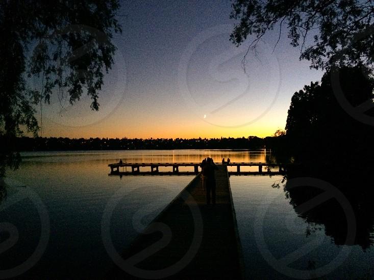 Dock at dusk chasing the light photo