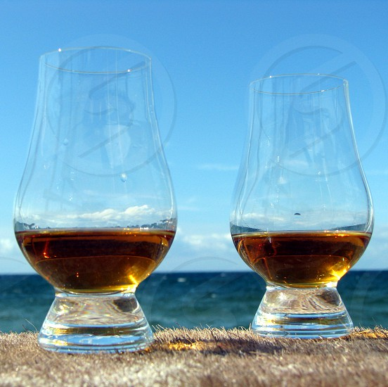 Whisky glass(es) captured at sunset - 8. photo