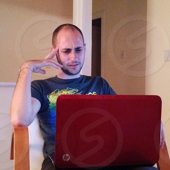 man facing laptop photo