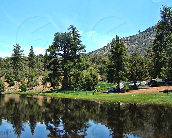 Camping by a mountain lake. photo