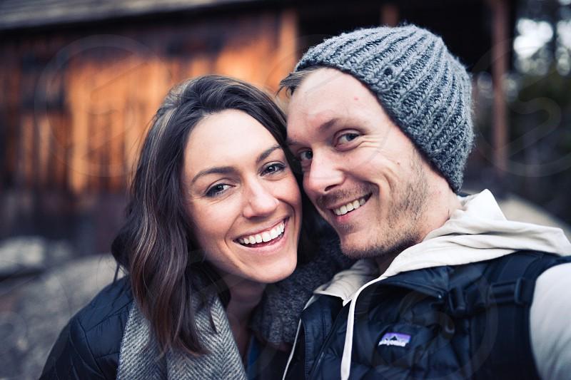 couple outdoors winter jolly photo