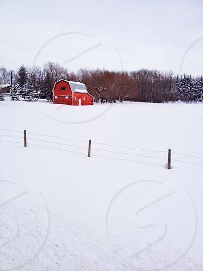 red and gray bunkhouse with snow covered floor photography photo