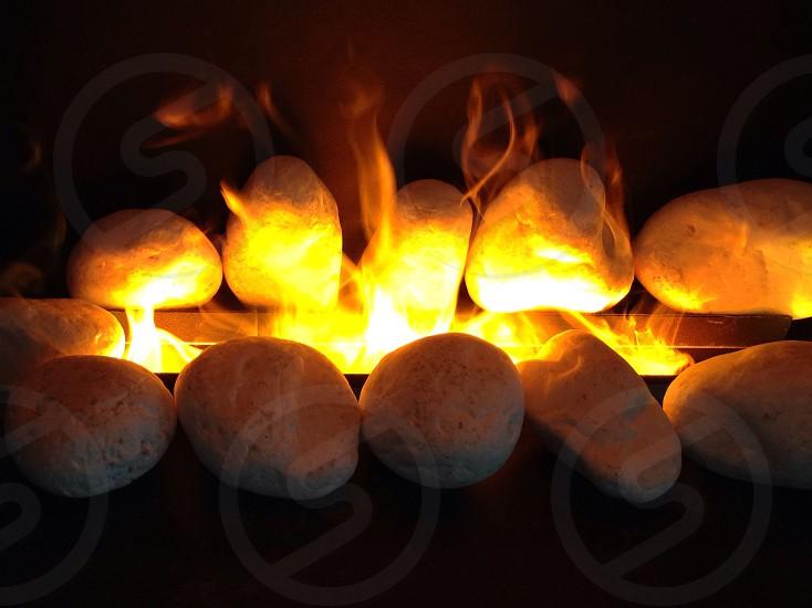 fire with rocks beside it photo