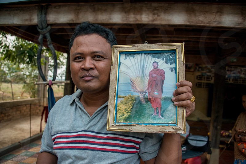 Man who used to be a monk outside his farm home in Cambodia. photo