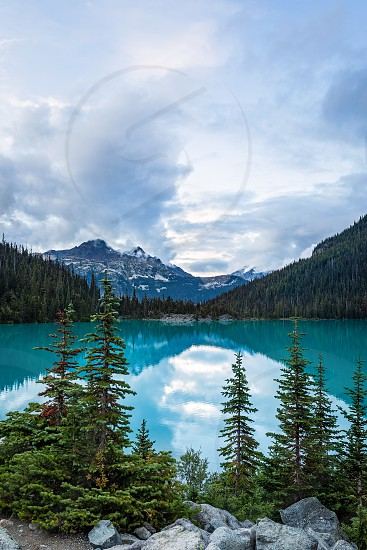 Mountain view of Mount Cayoosh and Upper Joffre Lake with pine trees in British Columbia Canada photo
