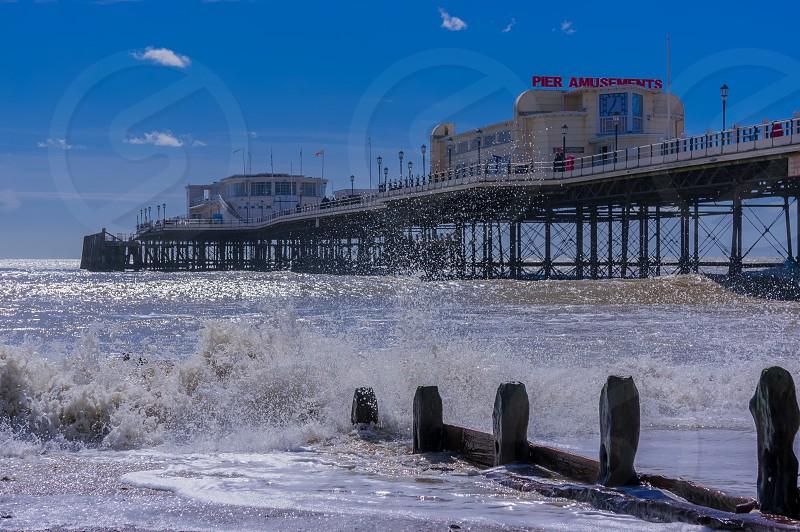 Worthing Pier surf waves sky blue ocean sea groyne  photo