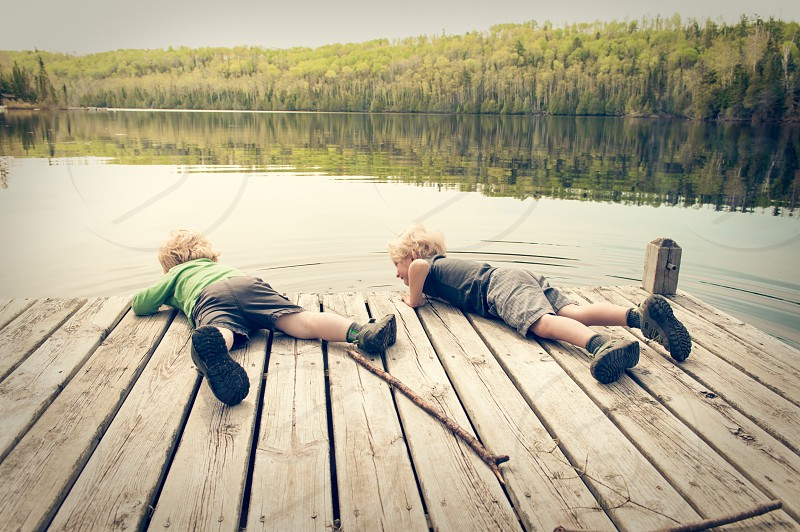authentic travel boys play dock water lake sunset evening trees fun children summer woods forest photo