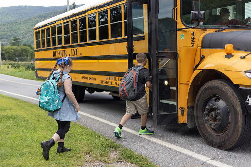 Kids getting on the school bus photo